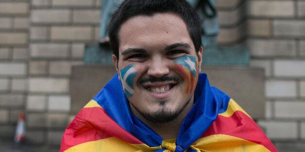 A Catalan man, is seen in the streets of Edinburgh with Catalan flag to support the 'Yes'