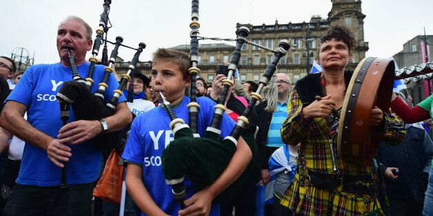 GLASGOW, SCOTLAND - SEPTEMBER 18: Pipers play in George Square, just a few hours before polling stations...