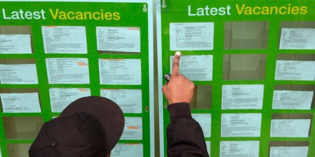 UNITED KINGDOM - DECEMBER 15: A jobseeker looks at the latest vacancies advertised at a Job Centre in...