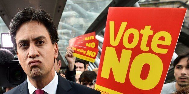 Labour Party leader Ed Miliband addresses the public and the media as he walks in Edinburgh, Scotland,...