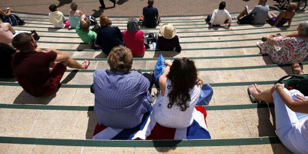 Fans on Murray mount soak up the sun during day three of the Wimbledon Championships at the All England...