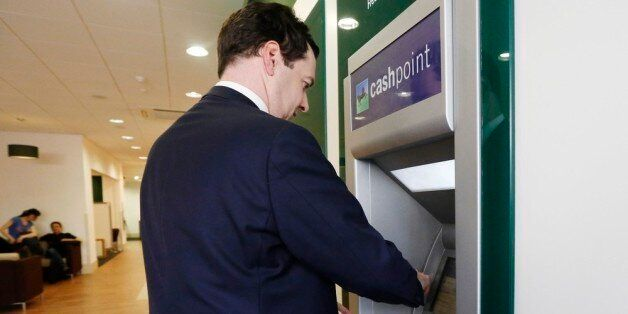LONDON, ENGLAND - JUNE 19: Britain's Chancellor of the Exchequer George Osborne withdraws money from...