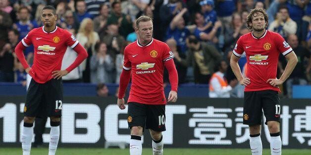 LEICESTER, ENGLAND - SEPTEMBER 21: Chris Smalling, Adnan Januzaj and Wayne Rooney of Manchester United...