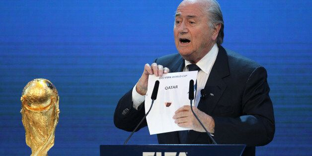 FIFA president Joseph Blatter opens the envelope to reveal that Qatar will host the 2022 World Cup at...