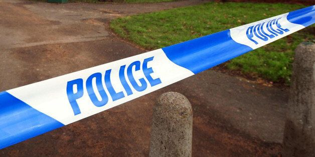 Undated file photo of a general view of police tape. Planned cuts by police forces fall £500 million...