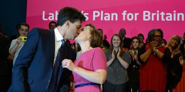 Justine Thornton (R) wife of the leader of Britain's opposition Labour Party Ed Miliband kisses her husband following his speech at Manchester Central, in Manchester on September 23, 2014 on the third day of the Labour Party conference. Conservative bashing, stirring words about social equality and warnings over populism: Britain's main opposition party this week prepped its ranks for next year's general election. 'Win 2015' flags were on display all around at the party conference in Manchester,