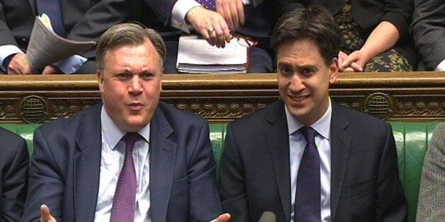 Shadow Chancellor Ed Balls (left) and Labour party leader Ed Miliband (right) listen during Prime Minister's...