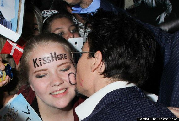 Johnny Depp Kisses Fan With Cheeky 'Kiss Here' Message On Her Face