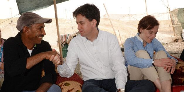 Labour leader Ed Miliband (centre) and his wife Justine (right) visit the Khan al-Ahmar Bedouin community...