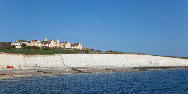 England, East Sussex, Brighton, white cliff coastline with Roedean private school for