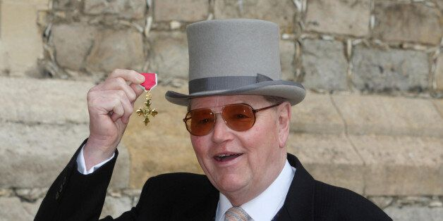 Former racehorse trainer Toby Balding poses with his medal after he was made an Officer of the Order...