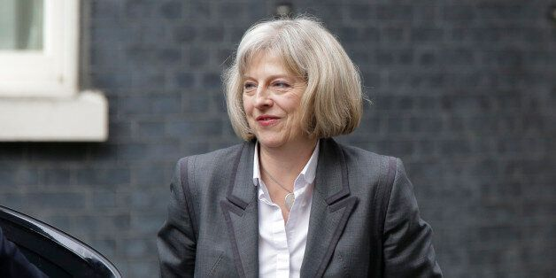 Britain's Home Secretary Theresa May arrives at British Prime Minister David Cameron's official residence...