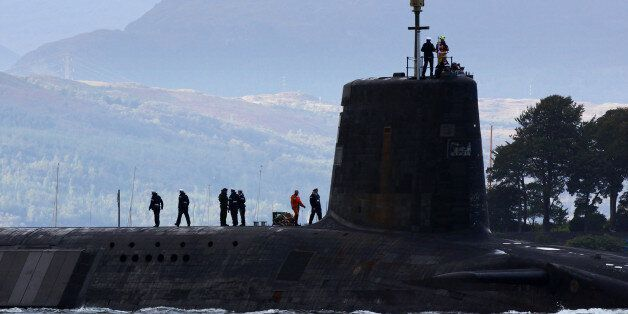 FASLANE, SCOTLAND - SEPTEMBER 23: A trident submarine makes it's way out from Faslane Naval base on September...