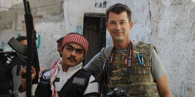 In this Nov. 11, 2012 photo, freelance British photojournalist John Cantlie poses with a Free Syrian...