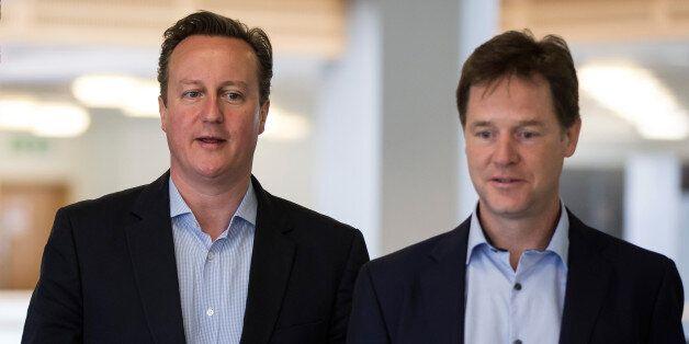 Prime Minister David Cameron (left) and Deputy Prime Minister Nick Clegg during a visit to Pentland Brands...