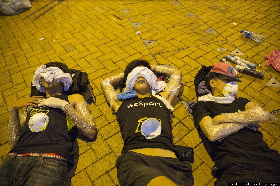 Hong Kong Protesters Pictured Wrapped In Protective Cling Film Ahead Of Expected