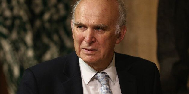 LONDON, ENGLAND - JUNE 04: British Business Secretary Vince Cable stands in the Members' Lobby before...