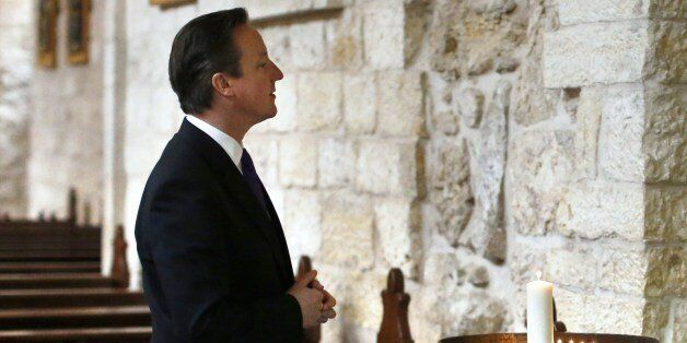British Prime Minister David Cameron visits the Church of the Nativity in the West Bank town of Bethlehem,...