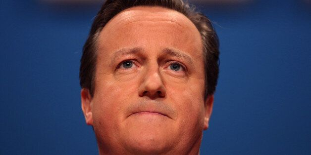 David Cameron, U.K. prime minister, pauses as he addresses delegates at the Conservative party's annual...