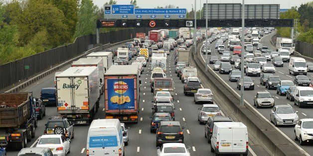 Motorists queue in heavy traffic on the M25 between junction 12 and 13 as the Easter getaway