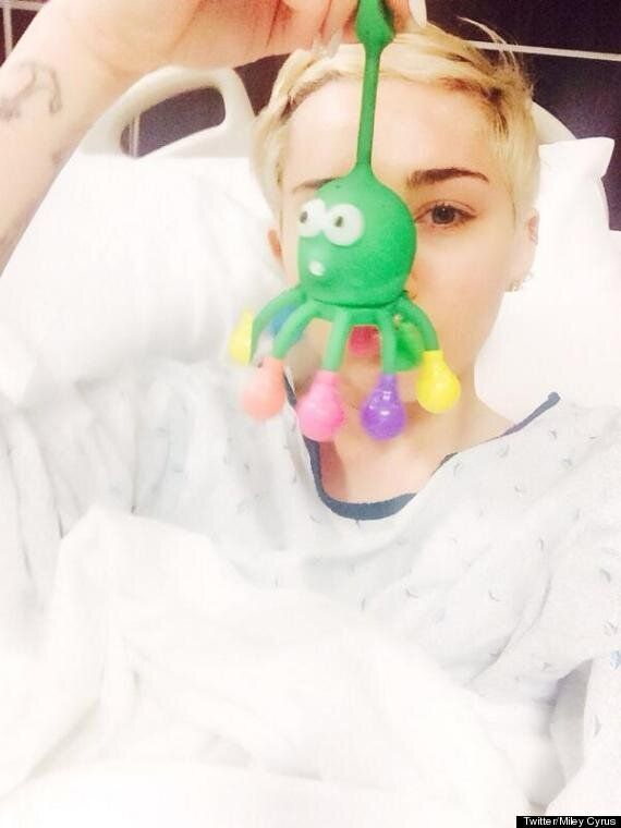 Miley Cyrus 'Bangerz' Tour: 'Wrecking Ball' Singer Cancels More Dates Due To Hospital Stay, Hits Out...