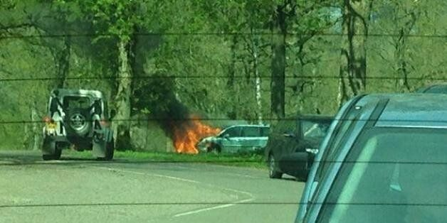 A mother and her two children had to abandon their car as it overheated and caught fire at Longleat Safari
