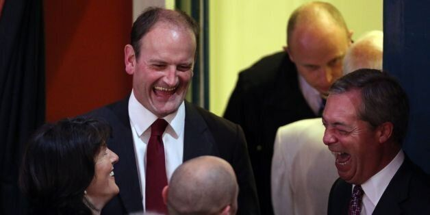 Douglas Carswell, with his wife Clementine share a joke with UKIP party leader Nigel Farage as they wait...