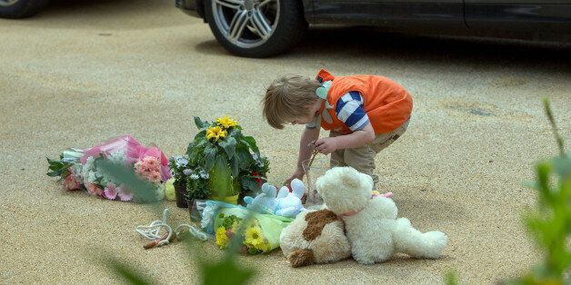 Members of the public lay flowers at a house in New Malden, south