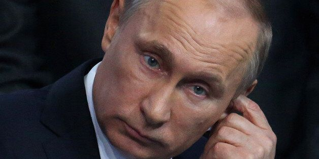 SAINT PETERSBURG, RUSSIA - APRIL 24: Russian President Vladimir Putin talks during a meeting with regional...
