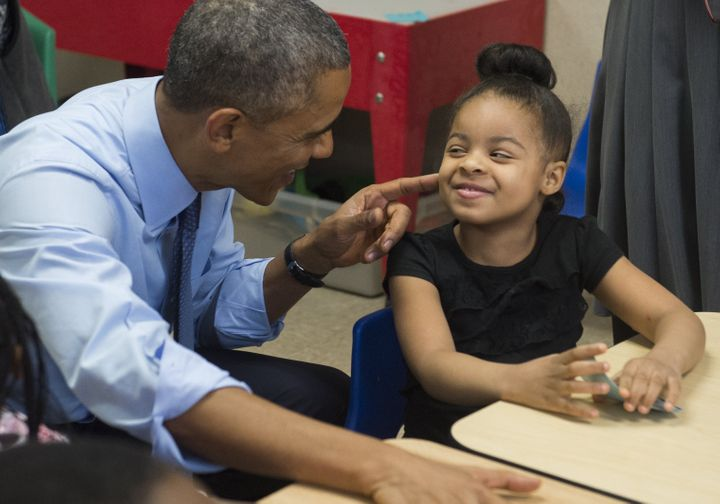 Obama talks with Akira Cooper during a visit to a classroom at the Community Children's Center in Lawrence, Kansas, in January 2015.