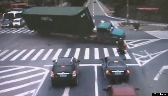 Motorcyclist Makes Amazing Escape From Lorry In China