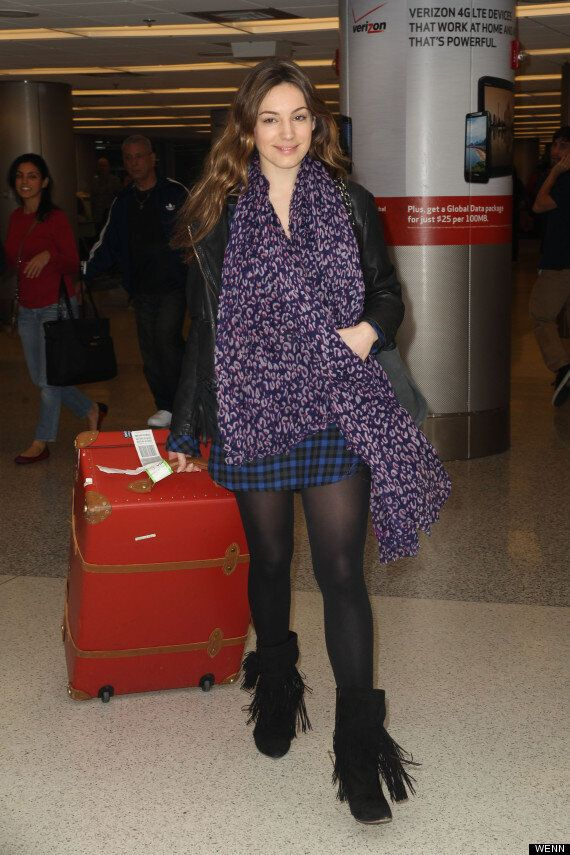 Kelly Brook Is All Smiles Arriving At Miami Airport After Confirming Thom Evans Split