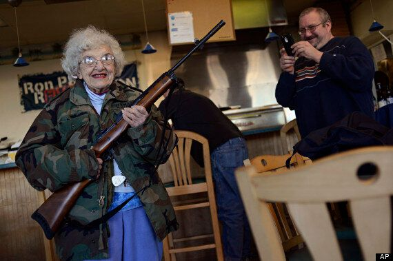 Thelma Lazernick, Pensioner Pictured Posing With Rifle At All Around Pizza Parlour Offering 15% Discount...