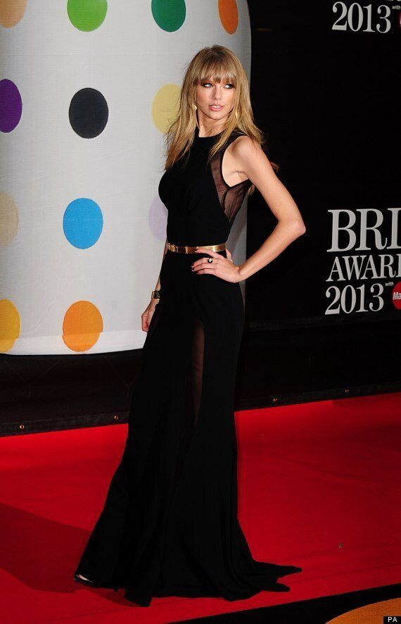 Brit Awards 2013: Taylor Swift Shows Harry Styles What He's Missing On Brits Red Carpet