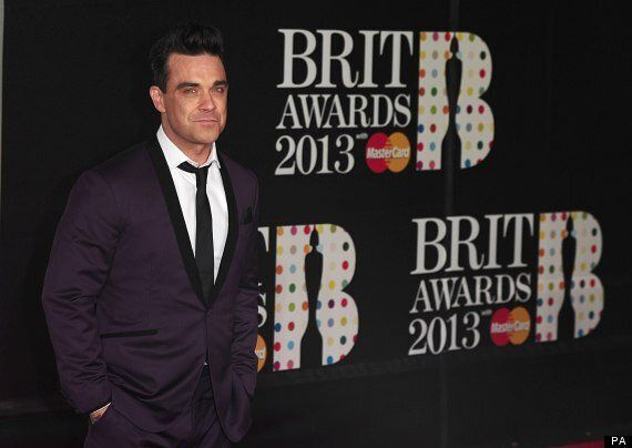 Brit Awards 2013: Robbie Williams Shows Off Result Of Weight Loss On Brits Red Carpet