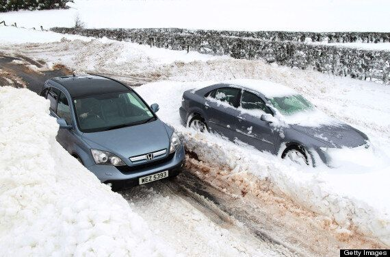 UK Weather: Heavy Snowfall Brings Down Power Lines, Traffic And Transport