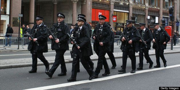 Armed Police walk up the Strand ahead of the funeral of Margaret