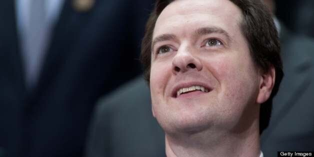 British Cancellor of the Exchequer George Osborne smiles before a family photo of finance ministers and...