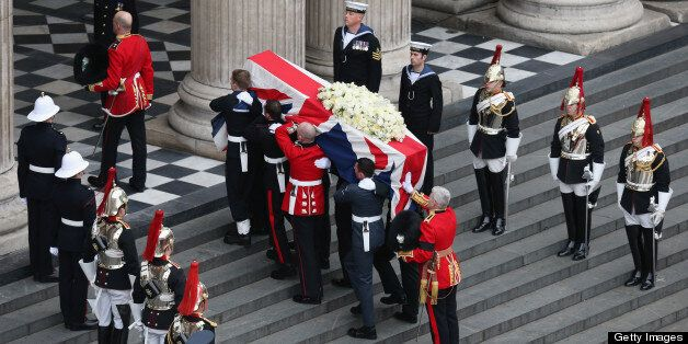 LONDON, ENGLAND - APRIL 17: Members of the Armed Services carry the coffin during the Ceremonial funeral...