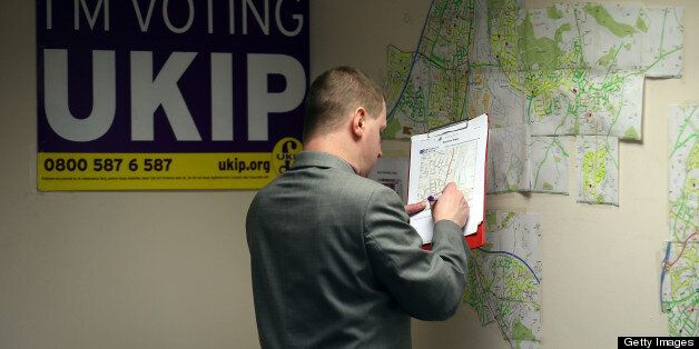 EASTLEIGH, HAMPSHIRE - FEBRUARY 22: A UKIP party activist checks maps in the office for local candidate...
