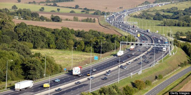 Aerial Photography view east of traffic on M25 Motorway highway north of Stapleford Essex RM4, England