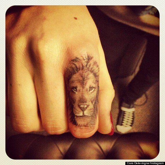 Cara Delevingne Debuts New Lion Tattoo On Her Finger