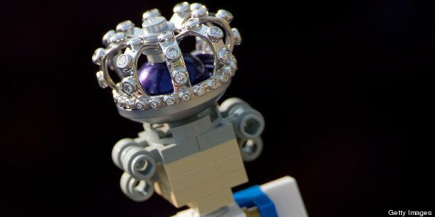 A 10cm high lego figure of Britain's Queen Elizabeth II, complete with a real diamond-encrusted crown,...