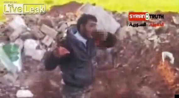 Syrian Rebel Abu Sakkar Filmed Eating Soldier's Lung Has No Regrets & Promises More Slaughter (GRAPHIC...