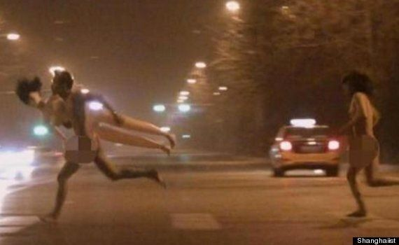 Naked Man Carrying Giant Cross Runs Through Beijing China: Can You Help Solve The Mystery?