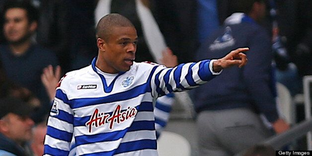 Queens Park Rangers' French striker Loic Remy celebrates after scoring the opening goal of the English...