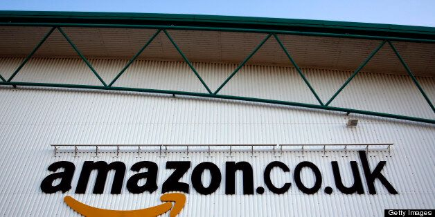 A logo sits on a wall outside the Amazon.co.uk Marston Gate 'Fulfillment Center,' the U.K. site of Amazon.com...
