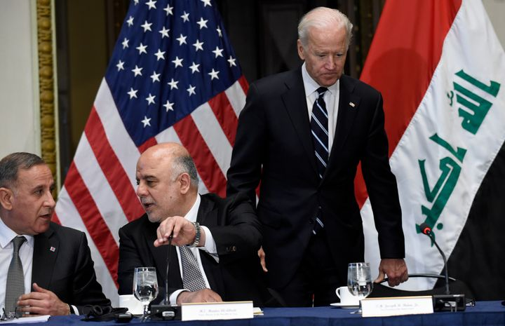 Biden arriving at an event with then-Iraqi Prime Minister Haider al-Abadi (second from left), whom the U.S. scrambled to help