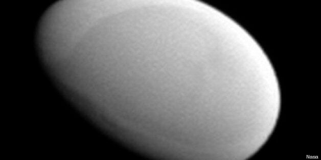 Saturn's Moon Methone Is Small, Oval And Made Of Fluff