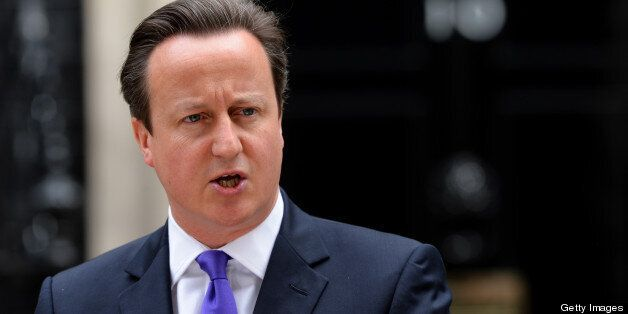 Britian's prime Minister David Cameron addresses media representatives at 10 Downing Street in London...